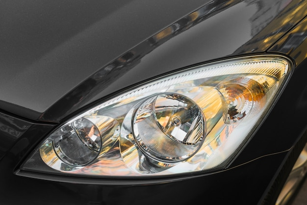 Led headlight of black automobile