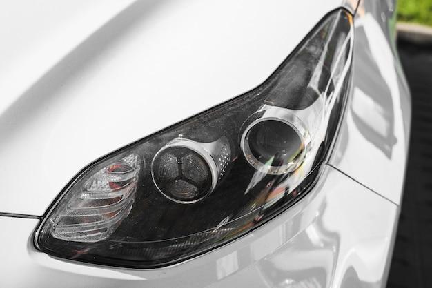 Led headlight of white car