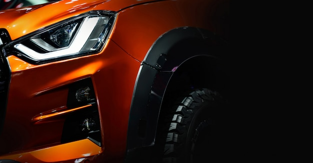 Led headlights on orange pickup truck