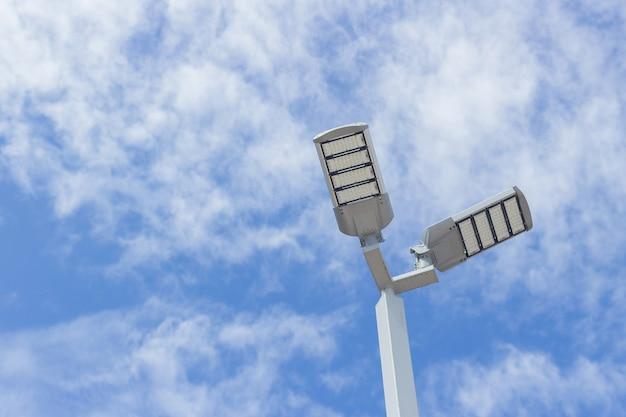 Led lamp on blue sky background