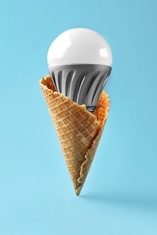Led lamp in ice cream cone innovation concept