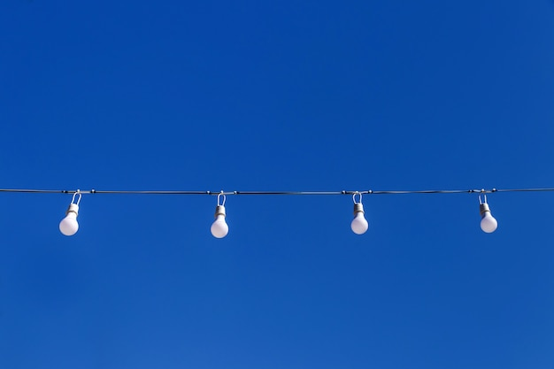 Led light blub in row on blue sky background