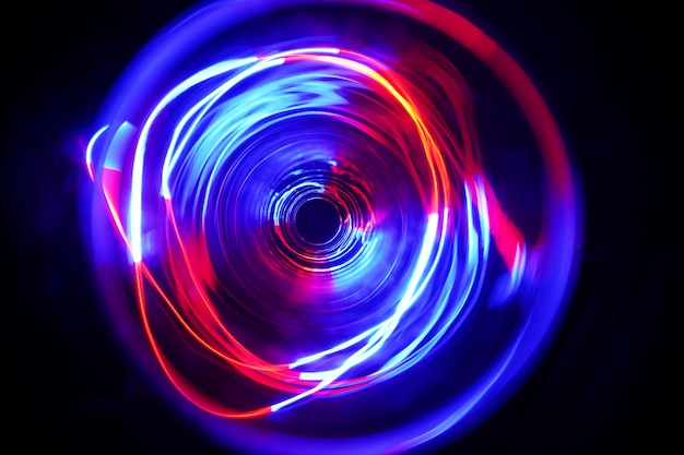 Led red & blue light moving on long exposure shot in the dark.