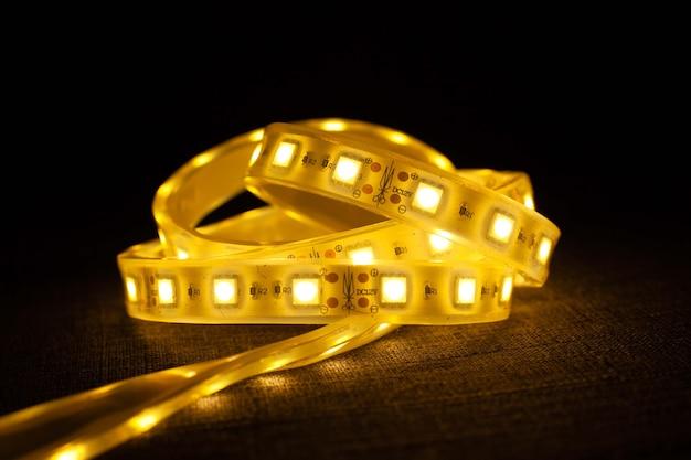 Светодиодная лента светящаяся декоративная подсветка крупным планом.