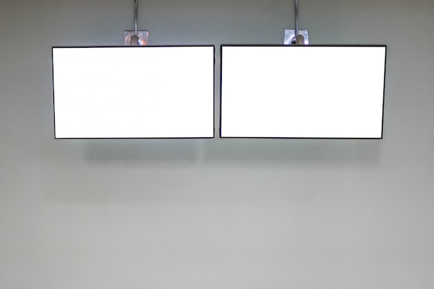 Led tv blank white screen mockup on the wall for design, advertising design concept.