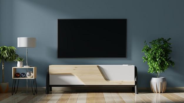 リビングルームの暗い壁にledテレビ、ミニマルなデザイン。
