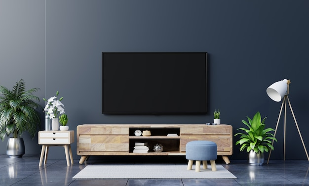 リビングルームの暗い壁にledテレビ、最小限のデザイン。