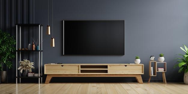 木製キャビネット付きのリビングルームの暗い壁にledテレビ、最小限のデザイン
