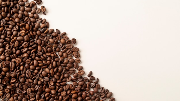 Left corner coffee beans with copy space
