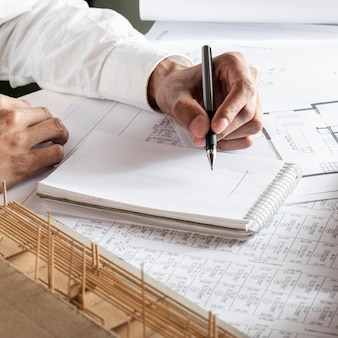 Left handed person drawing a blueprint