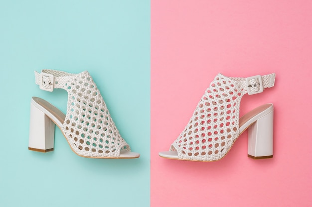 Left and right summer women's shoes on the border of pink and blues.