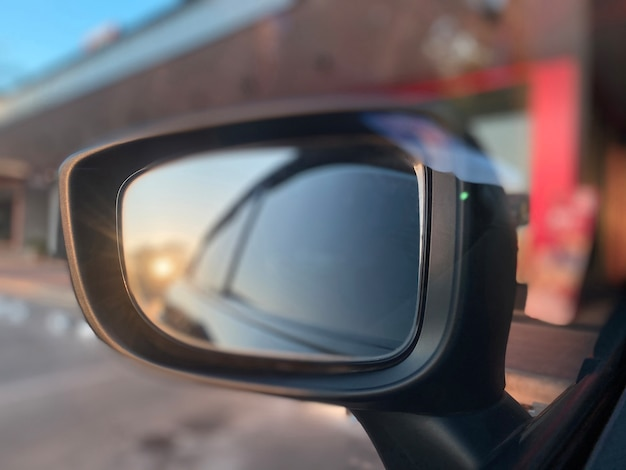 Left side mirror reflected with the evening sun shining beautiful