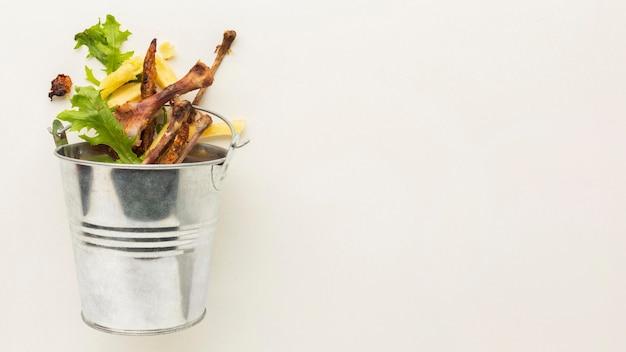 Leftover food waste bucket copy space
