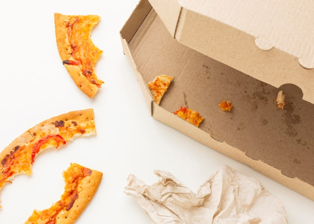 Leftover pizza food and dirty napkin