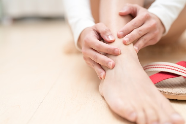 Leg ankle painful women touching leg. healthcare and medical concept