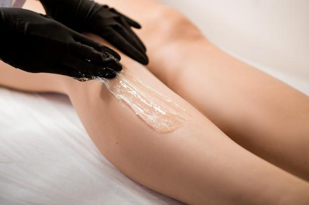 Leg depilation with wax