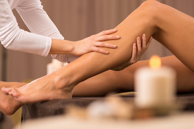 Leg massage at spa salon