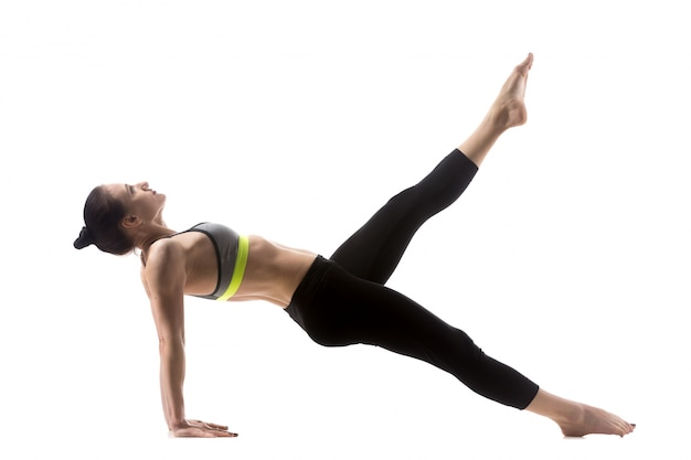 Woman doing pilates legs pull up