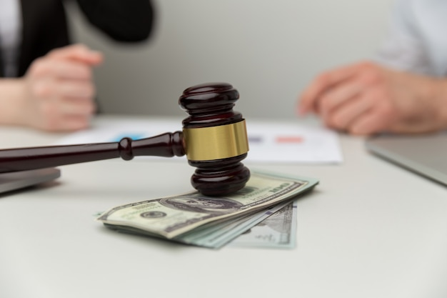 Legal alimony concept. closeup view of wooden gavel and money.