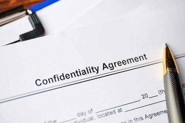 Legal document confidentiality agreement on paper close up.