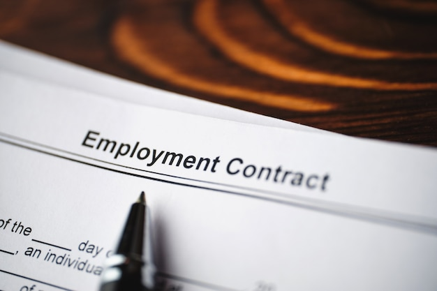 Legal document employment contract on paper close up.