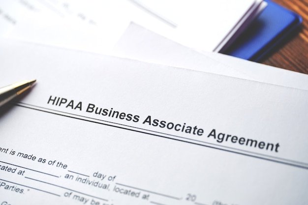 Legal document hipaa business associate agreement on paper close up.