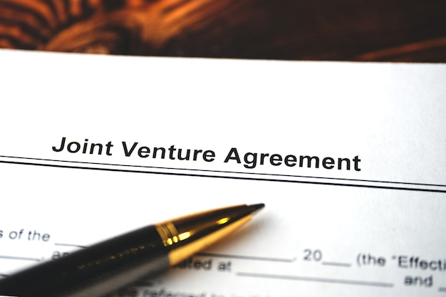 Legal document joint venture agreement on paper close up.