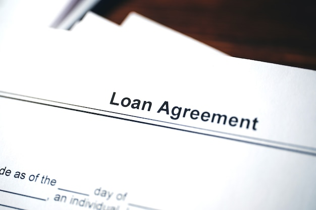 Legal document loan agreement on paper close up.