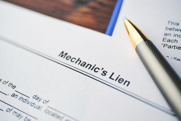 Legal document mechanic lien on paper close up.