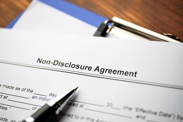 Legal document non-disclosure agreement on paper close up.