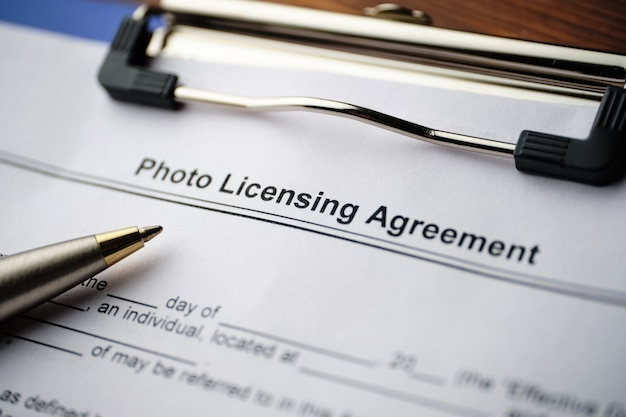 Legal document photo licensing agreement on paper close up.