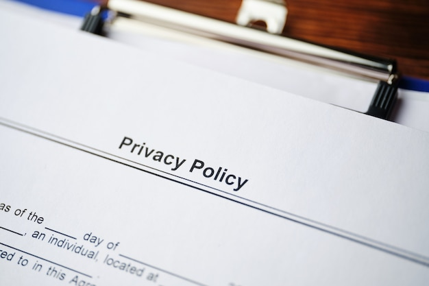 Legal document privacy policy on paper close up.