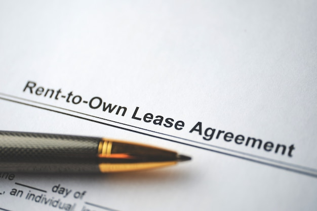 Legal document rent-to-own lease agreement on paper close up.