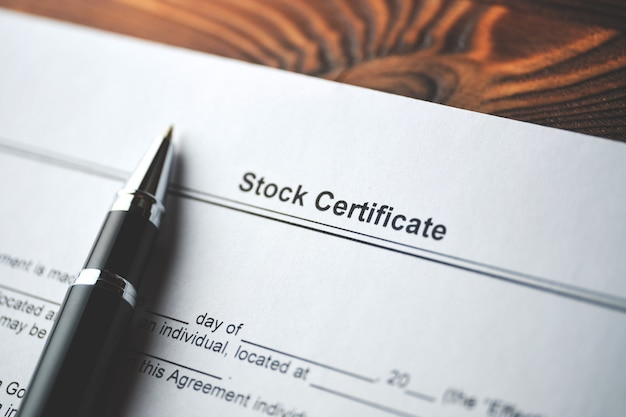 Legal document stock certificate on paper close up.