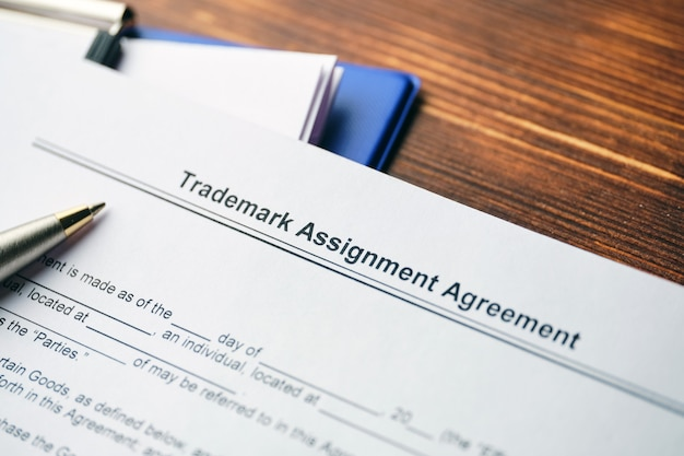 Legal document trademark assignment agreement on paper close up.