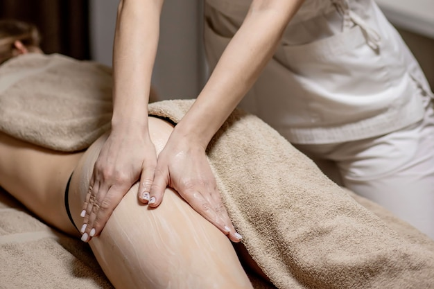 Legs and buttocks massage to reduce cellulite and phlebeurysm and preserve an healthy look. skin and bodycare. recovery.