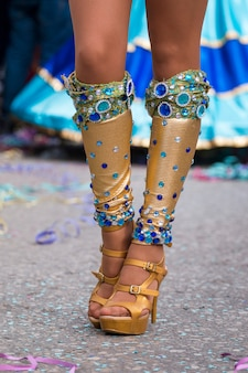 Legs of carnival dancer