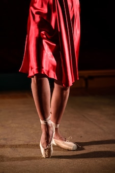 The legs of the dancer.
