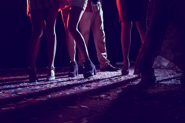 Legs of dancing people at the party.