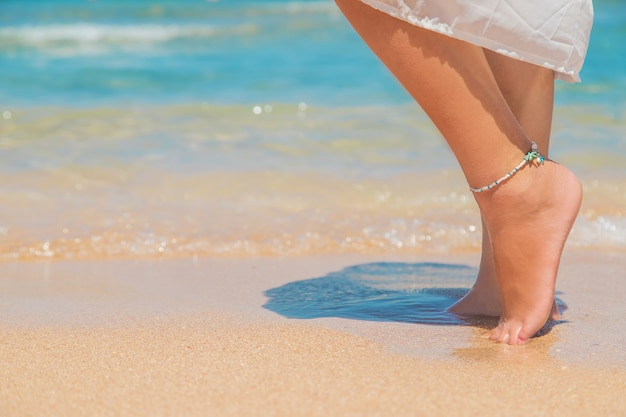 Legs of a girl on the seashore