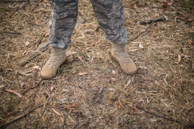 Legs of military soldier in standing in boot camp