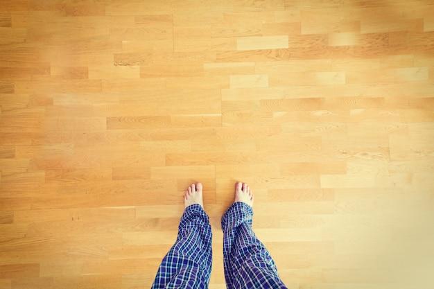Legs in pajamas.