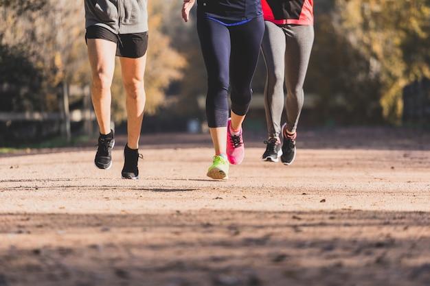 Legs of people running close-up