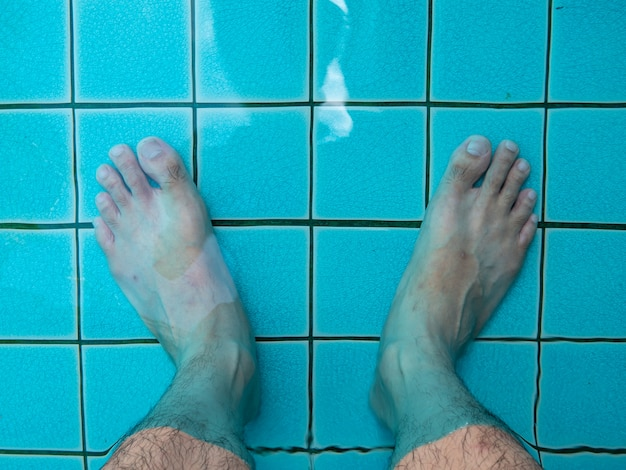Legs in the pool water. summer traveling background