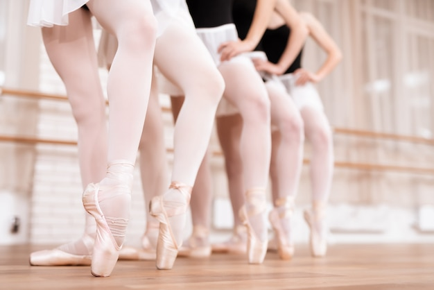 Legs of professional ballet dancers in class.