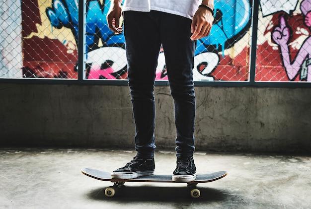 Legs standing on skateboard