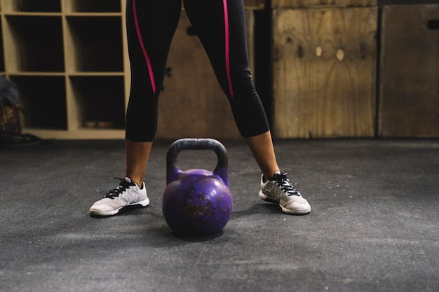 Legs of woman and kettlebell