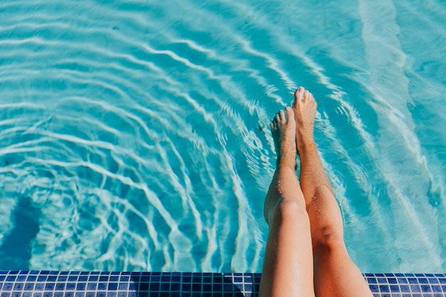 Legs of woman at pool