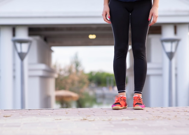 Legs of a woman who is running outdoors