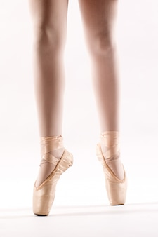 Legs of a young ballerina on pointe